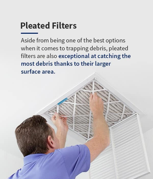 a pleated filter being installed